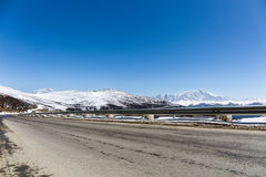 Highway with snow mountain Royalty Free Stock Photos