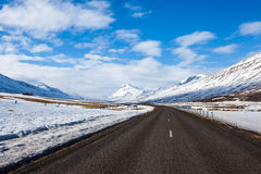 Highway and snow mountain in Iceland Stock Photo