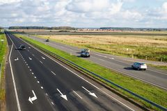 Highway with some cars. Two lane highway with vehicles stock photos