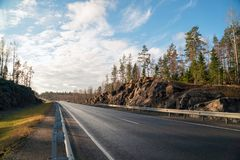 Highway A-121 Sortavala in Karelia. Russia. Autumn. Autumn landscape highway A-121 Sortavala in Karelia. Russia royalty free stock photo