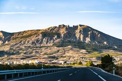 Highway in Spain leading to mountains Sierra Nevada royalty free stock image