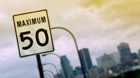Highway speed sign. A view of a highway speed sign with the skyline of Montreal, Canada, in the background royalty free stock images