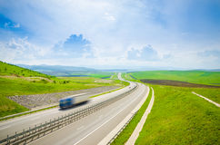 Highway with speeding truck stock photos