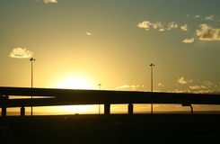 Highway in the Sun. Two overpass stretch high across a brilliant sky Royalty Free Stock Photography