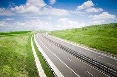 Highway on a sunny  landscape Stock Images