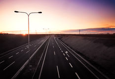 Highway at sunset Stock Image