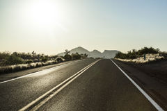Highway in sunset Royalty Free Stock Image