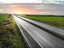 Highway to sunset royalty free stock photography