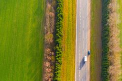 Highway surrounded by hedge aerial view. Travelling concept. Highway surrounded by green hedge aerial view. Travelling concept. Drone photography stock photos