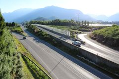Highway in switzerland with mountain in background. Cars driving on a highway in switzerland. Mountain in background Royalty Free Stock Photography