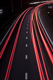 Highway tail lights at night Stock Images