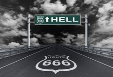 Highway with a text Hell on the road sign Stock Photos