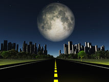 Highway to city and large moon Stock Images