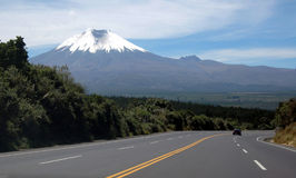 Highway to the Cotopaxi volcano. Highway to Andean valley and to the majestic Cotopaxi (the highest active volcano in the world), in the Andes, Ecuador, South Stock Photography