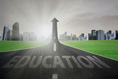 Highway to get better education. Empty road with Education text turning into arrow upward, symbolizing the way to get better education and bright future royalty free stock images