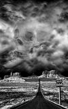 Highway to Hell, Route 666 Halloween, Evil, Devil. An evil human skull from the devil appears through smoke and clouds above the Highway to Hell, or Route 666. A royalty free stock photography
