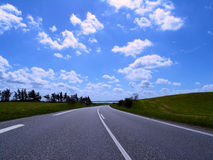 Highway in to horizon. Highway in to the horizon of summer landscape, jutland, denmark royalty free stock photos