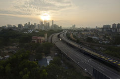 Highway to Kuala Lumpur city during sunset Stock Images