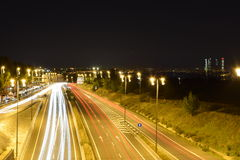 Highway to Madrid in the night. Highway full of traffic to Madrid in the night. Long exposure photo shows the dynamism that big cities normally sugest Royalty Free Stock Image