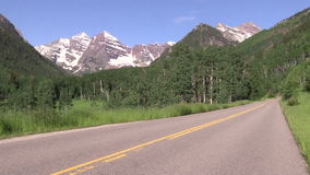 Highway to the Maroon Bells. The road leading to the scenic maroon bells aspen colorado in summer stock video