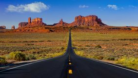 Highway 163 to monument valley. Monument valley long road with no cars Stock Image