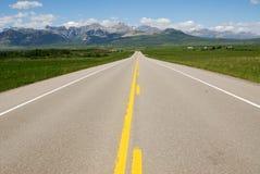 Highway to mountains Stock Photos