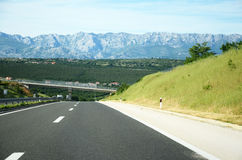 Highway to the mountains Royalty Free Stock Images