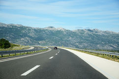 Highway to the mountains Royalty Free Stock Image