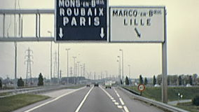 Highway to Paris. Touristic bus travelling to Paris on the highway s of France. Historic restored footage on 1976 in France stock video
