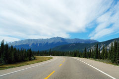 Highway to rocky mountains Royalty Free Stock Photography