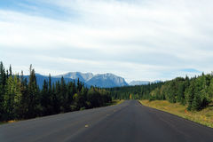 Highway to rocky mountains Royalty Free Stock Image