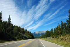 Highway to rocky mountains stock photography