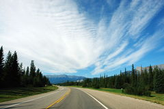 Highway to rocky mountains Stock Photos