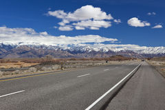 Highway to snow-capped mountains Stock Image