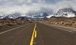 Highway to the stormy mountains Stock Images