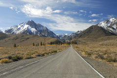 Highway toward Sierra Nevada mountains Royalty Free Stock Image