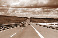Highway traffic. Highway in sepia (grainy, ISO 800 Stock Photos