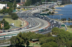 Highway traffic. Looking down on a highway scene of cars driving beside a river stock photos