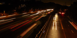 Highway Traffic. At night with carlights passing by stock images