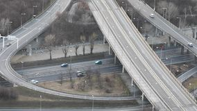 Highway traffic from above. Highway traffic with overpass, evening light stock video footage