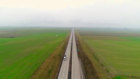 Highway traffic of car and trucks aerial video drone. 4k stock video footage