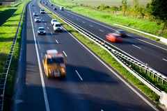 Highway traffic, cars motion blur Royalty Free Stock Images