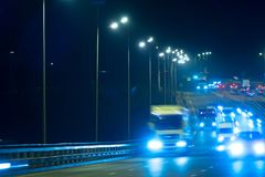 Highway traffic cars at night blured. Cars moving on road on bri Stock Photos
