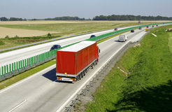 Highway traffic. Cars and trucks on highway Stock Photo