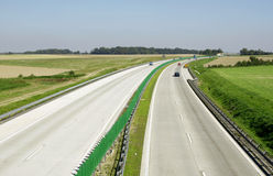 Highway traffic. Cars and trucks on highway Royalty Free Stock Photography