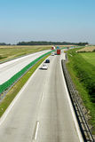 Highway traffic. Cars and trucks on highway Royalty Free Stock Photos