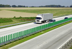 Highway traffic. Cars and trucks on highway Stock Images