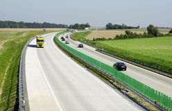Highway traffic. Cars and trucks on highway Royalty Free Stock Image