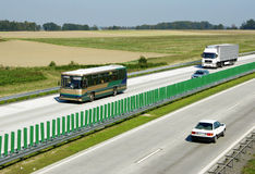 Highway traffic. Cars and trucks on highway Stock Photography