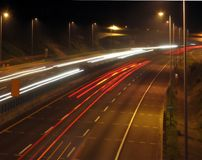 Highway Traffic at Evening Time. On a six lane expressway Royalty Free Stock Photos